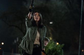 "Olivia Munn, left, and Jacob Tremblay star in Twentieth Century Fox's ""The Predator."""
